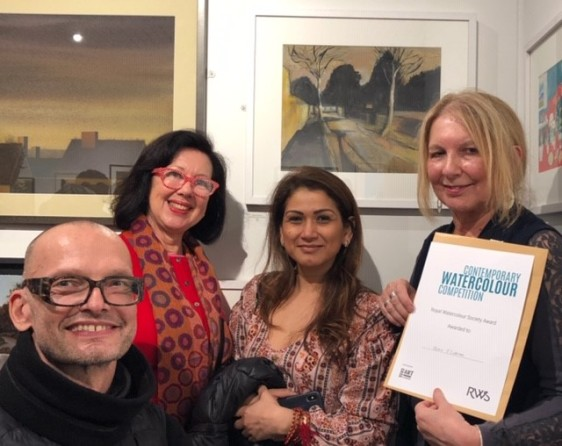 Olivia with her prize certificate and some of the other artists from the Holborn Group.