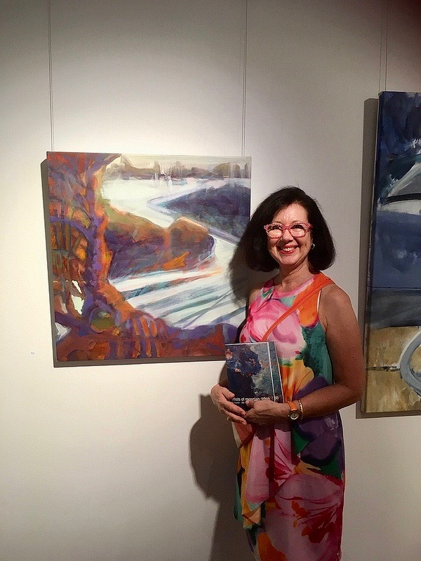 Linda Gold with her painting 'Nielsen Evening' at the Mosman Gallery.