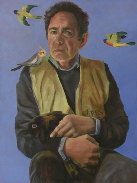 Portrait of a man, seated, with tame birds.